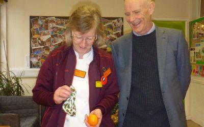 Sainsbury's distribute oranges to the children